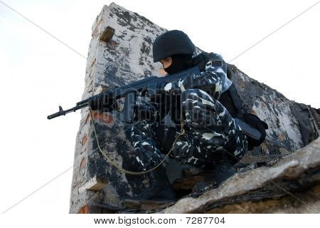 Soldier With A Rifle Targeting From The Hideout Postion