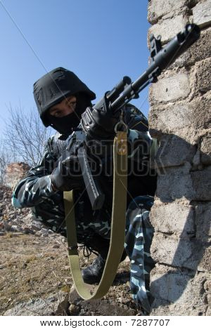 Soldier With Automatic Rifle In Covered Postion