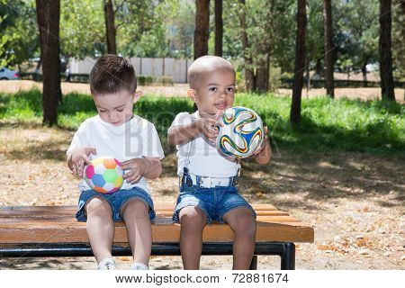 Little Boys: African American And Caucasian  With Soccer Ball In Park On Nature At Summer. Use It Fo