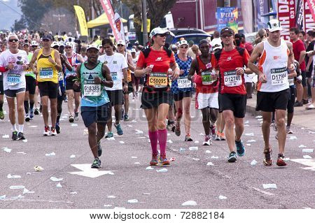 Male And Female Runners At Comrades Ultra Marathon