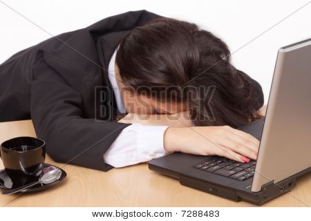 Young Woman Sleeping At Work