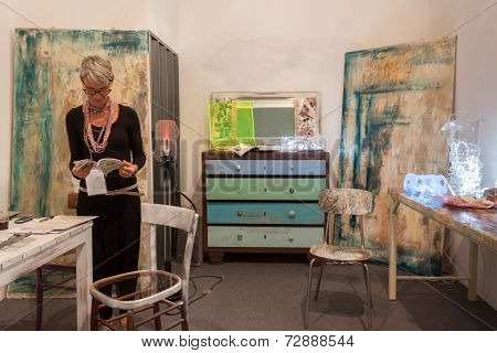 Exhibitor In Her Stand At Homi, Home International Show In Milan, Italy