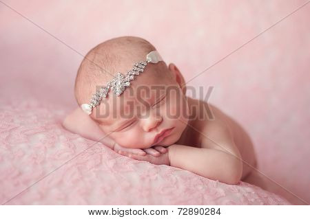 Newborn Baby Girl Wearing A Rhinestone Headband
