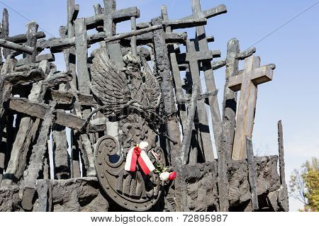 Monument With Crosses And The Emblem Of Poland