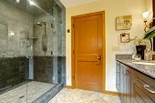pic of orange  - Modern bathroom interior with glass door shower and tile wall trim - JPG