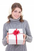 stock photo of muffs  - happy attractive woman in woolen sweater and muffs holding gift box isolated on white background - JPG