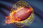 picture of nebraska  - American football ball with flag on backround series  - JPG