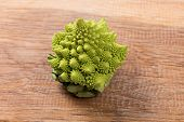pic of romanesco  - Tasty Lone romanesco on a wooden board - JPG