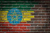 image of ethiopia  - Very old dark red brick wall texture with flag  - JPG