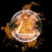 image of illuminati  - digital composition of a burning Symbol eye on a pyramid - JPG
