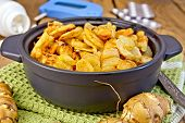 image of jerusalem artichokes  - Jerusalem artichokes roasted in a roasting pan fresh tubers on a napkin the meter and pills on the background of wooden boards - JPG