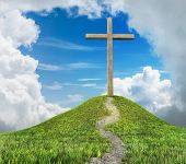 image of cross hill  - cross on hill and white clouds with blue sky - JPG