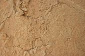 foto of mud  - Background texture of mud wall plaster with cracks - JPG