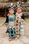stock photo of hmong  - Girls of Laos ethnic group Hmong portrait in traditional clothes - JPG