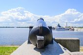 stock photo of artillery  - Battle cannon on the waterfront in Kronstadt - JPG