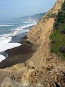 picture of bluff  - Surf and bluffs on the Pacific Coast at Pt - JPG