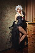 stock photo of wig  - Young attractive courtesan in a lush wig and dressed in a tight fitting corset dress - JPG