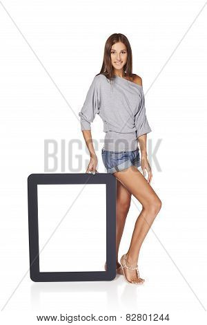 Woman showing blank empty screen with copy space