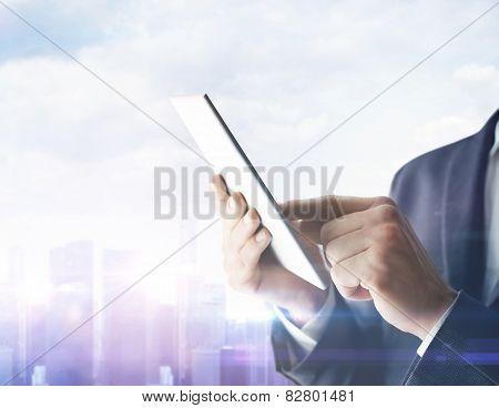 Businessman With Digital Tablet On Blurred City Background