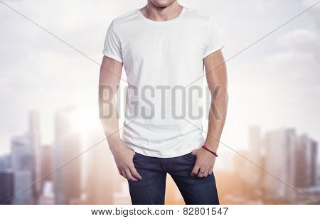 Man Wearing White T-shirt On Blurred City Background
