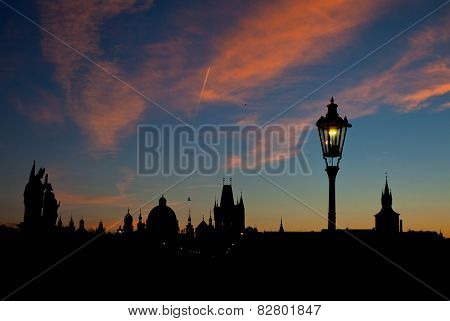 Silhouette View Of Charles Bridge And City Of Prague At Dawn