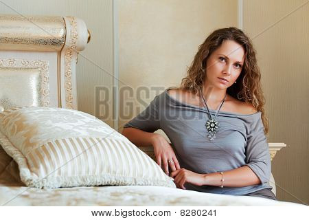 Beautiful Woman Near The Bed.