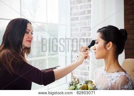 Make-up Artist Doing Make Up For Young Beautiful Bride