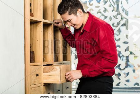 Korean man shopping cabinet in Asian furniture store