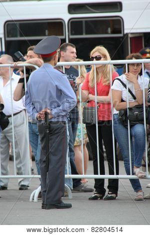 The Police Officer And The Girl Behind A Fencing Of Oppositional Meeting