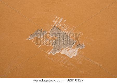 Mark of paint scraper on wall