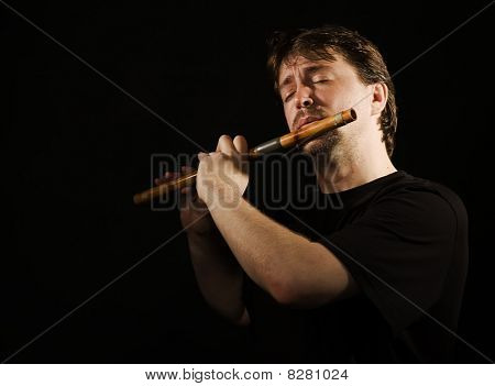 Man In Black Plays A Flute