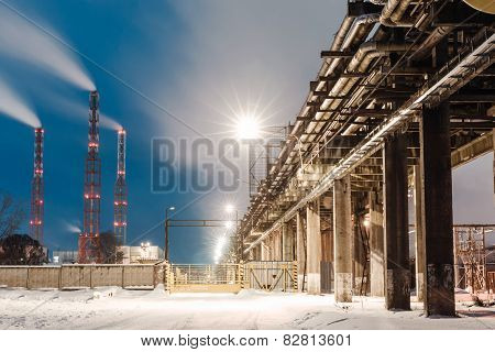 Many Pipes And Smokestacks With Industrial Tower
