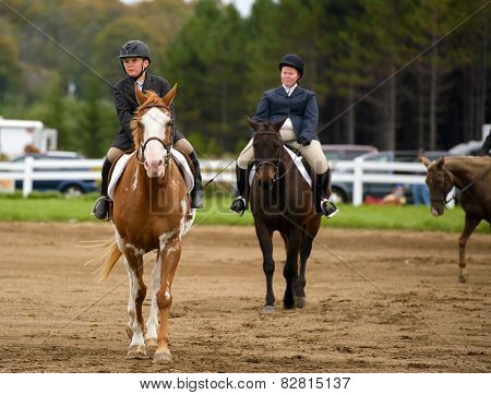 Two Riders At A Horse Competition