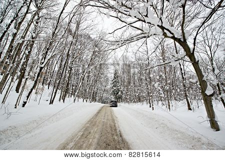 Car On A Snow Covered Rural Road