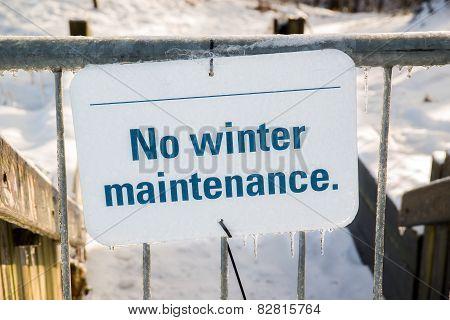 Frozen No Winter Maintenance Sign On A Gate