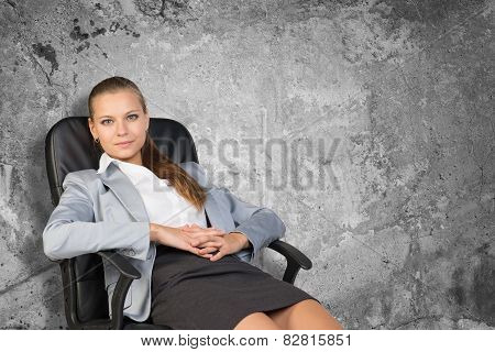 Businesswoman sitting back in office chair