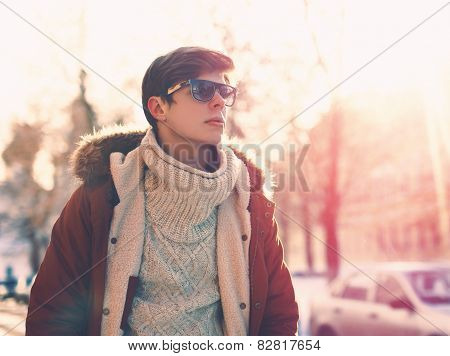 Fashion, Clothes And People Concept - Portrait Of Stylish Young Man In Sunglasses Outdoors