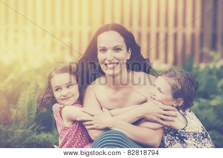 Daughters Hugging Their Mother - Retro