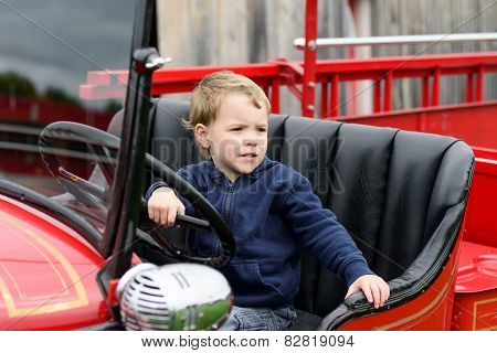Boy In A Vintage Fire Truck