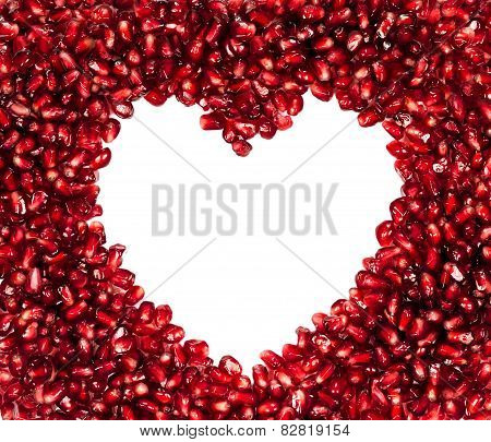 Fresh Pomegranate Seeds In A Heart-shaped Isolated On A White