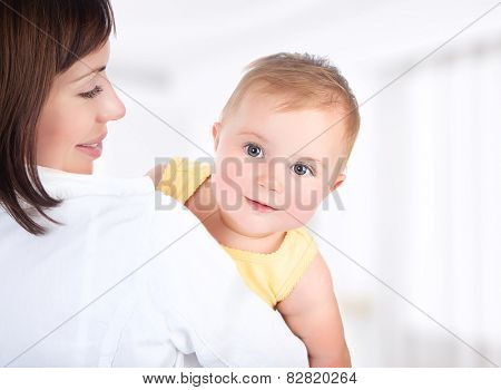 Happy mother and baby portrait, people having fun at home, healthy family enjoying life, parenting lifestyle