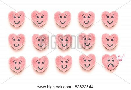 Happy Candy Hearts In Rows With One Bitten Sad Candy