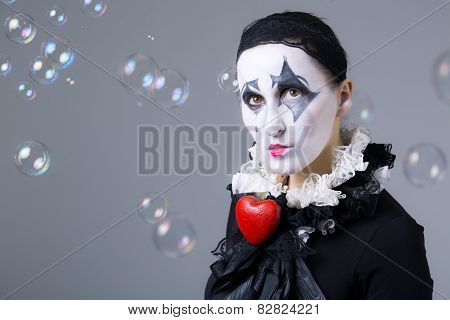 Woman In Disguise Harlequin With Soap Bubbles In The Background