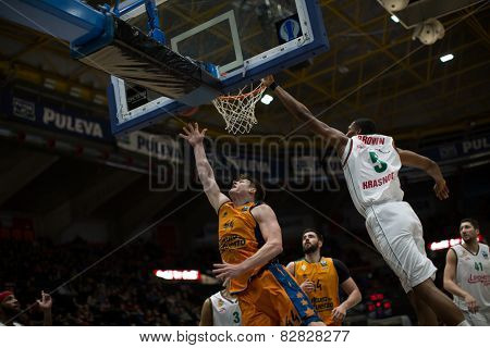 VALENCIA, SPAIN - FEBRUARY 11: Harangody with ball, Brown 5 during Eurocup match between Valencia Basket Club and Lokomotiv Kuban Krasnodar at Fonteta Stadium on February 11, 2014 in Valencia, Spain