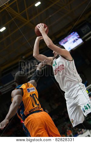 VALENCIA, SPAIN - FEBRUARY 11: Sato 10, Kurbanov 41 during Eurocup match between Valencia Basket Club and Lokomotiv Kuban Krasnodar at Fonteta Stadium on February 11, 2014 in Valencia, Spain