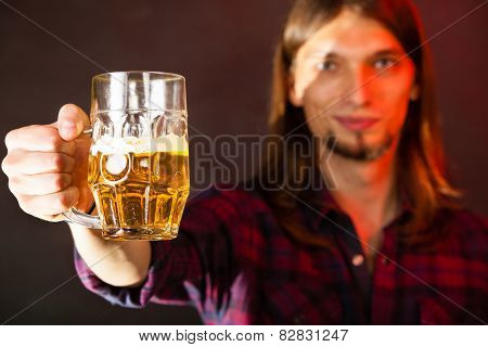 Handsome Young Man Holding A Mug Of Beer