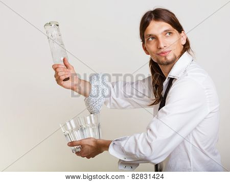Young Man Bartender Pouring A Drink, Studio Shot