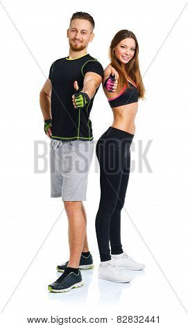 Sport Man And Woman After Fitness Exercise With A Finger Up On The White