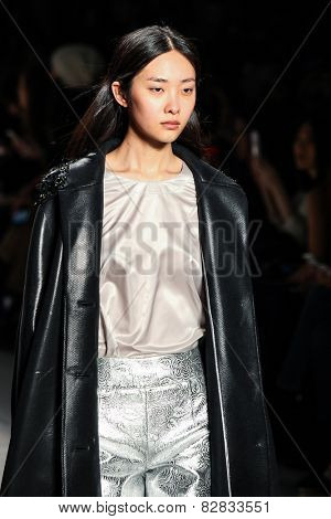 NEW YORK - FEBRUARY 14: A model walks the runway at the Noon by Noor Fall/Winter 2015 collection during Mercedes-Benz Fashion Week in New York on February 14, 2015.