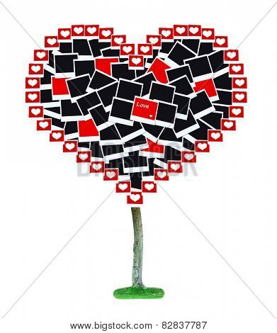 Big heart-shaped tree made of photo cards isolated on white